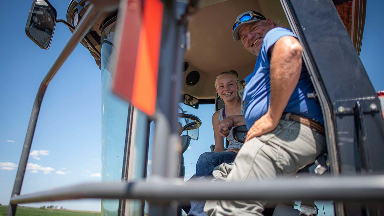Young female in combine with her father.