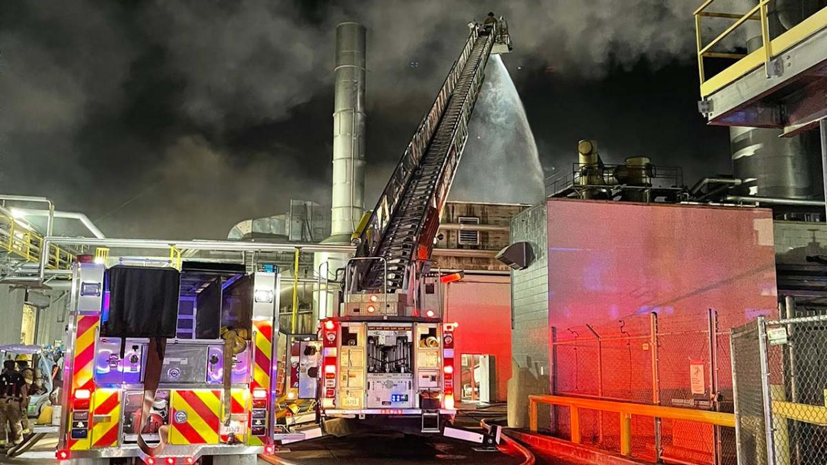 Fire engines working to extinguish plant fire.