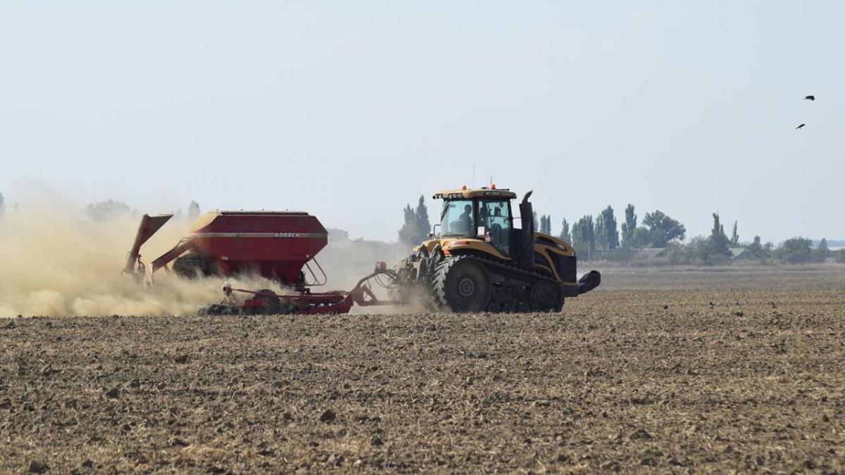 Machinery fertilizing field.