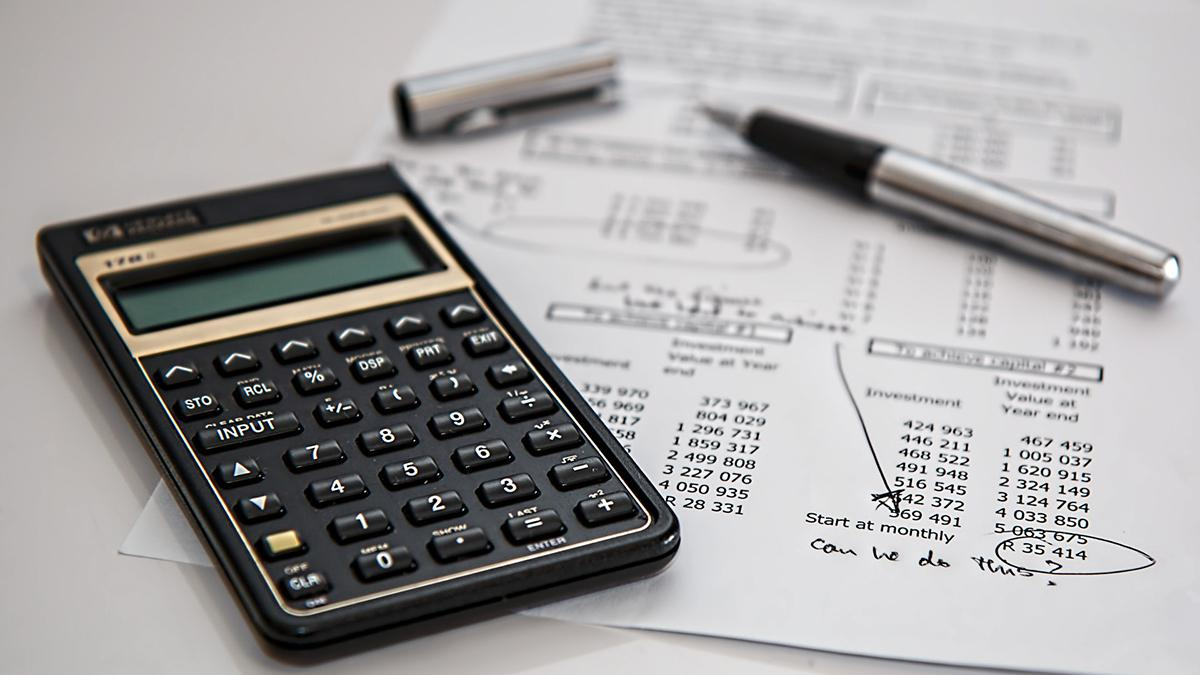 Calculator and accounting sheets.