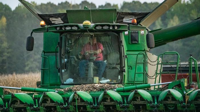 Man driving combine.