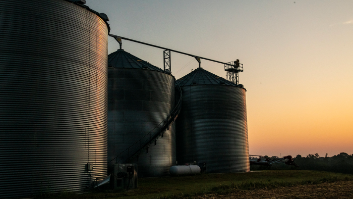 Grain bins at dusk.