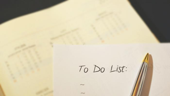 To-do list with calendar in background