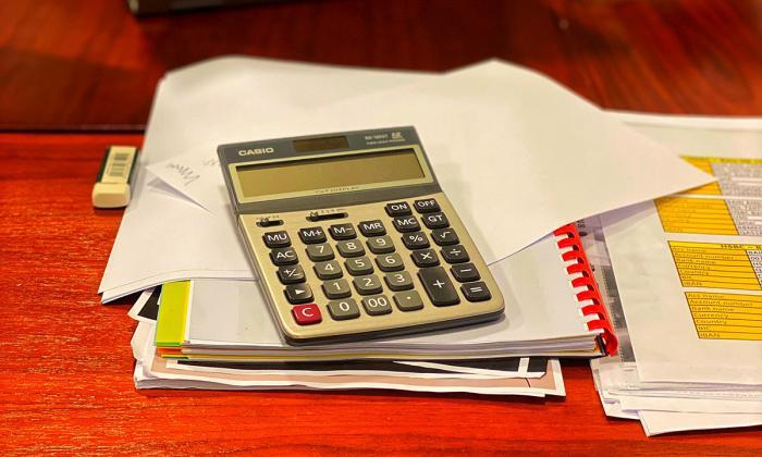 Calculator, book and pen.